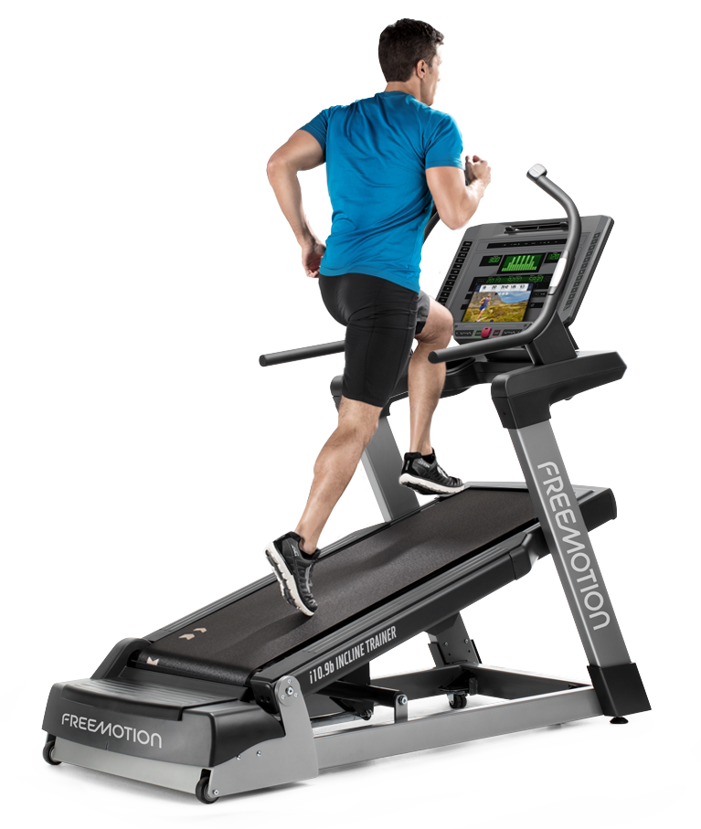 Man running on an inclined Freemotion treadmill.