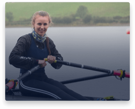 iFit Trainer Aifric Keogh rowing on the water in Ireland.