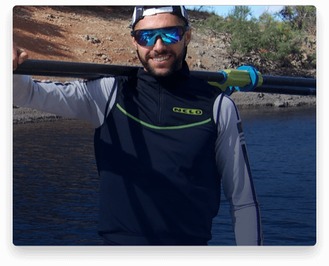 iFit Trainer Afonso Duarte Costa standing with his rowing oars.