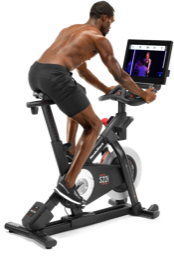 Man working out on a stationary bike.