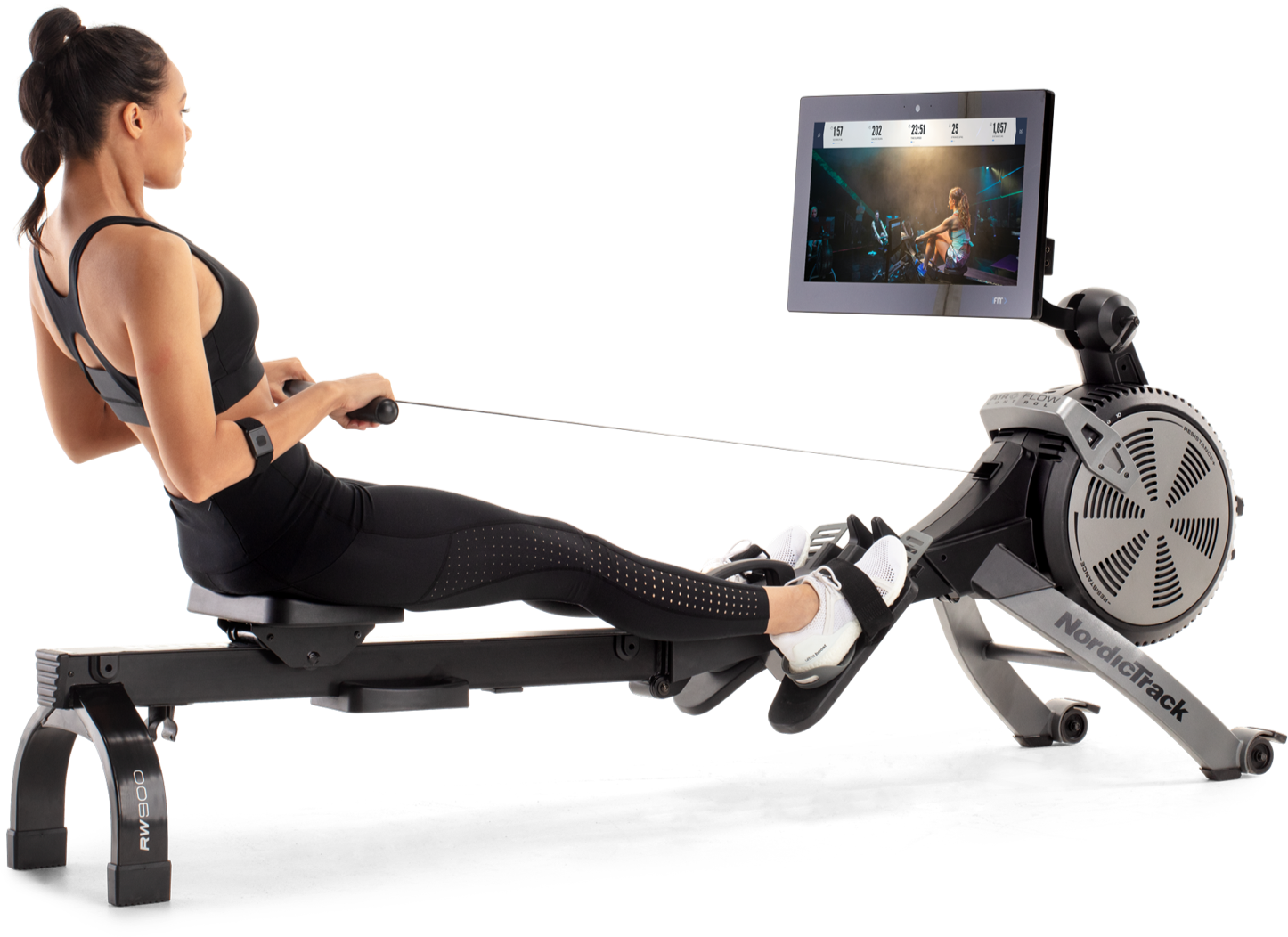 Woman rowing on a rower with the iFit app.