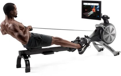A man exercising on a rowing machine.
